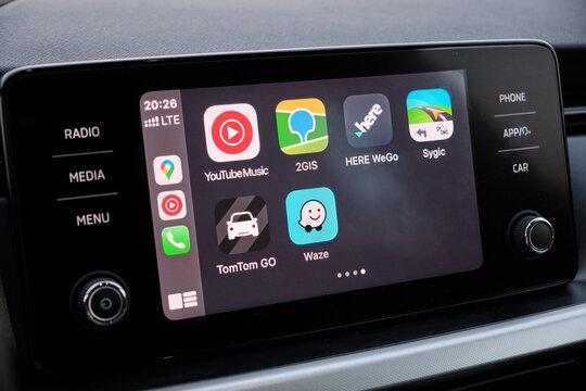 Apple CarPlay screen in the car dashboard. Youtube music, Waze, 2GIS, Here WeGo, Sygic, TomTom Go logo on the screen in the automobile, August 2020, San Francisco, USA