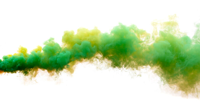 Green and yellow smoke isolated on a white