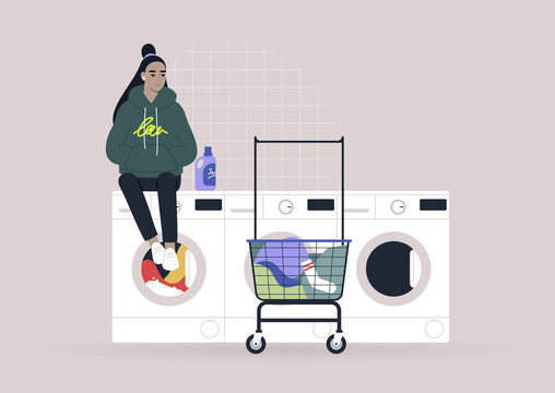 Household chores concept, a young female Asian character waiting for their laundry in a coin laundromat
