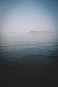 Distant Mountains and Calm Water Across The Great Salt Lake.