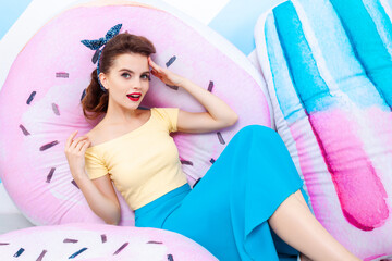 Sexy surprised woman with donut and ice-cream. Colorful background in pop art retro comic style on...