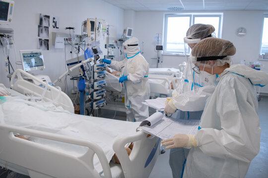 Nurse is preparing intravenous medication in intensive care unit.