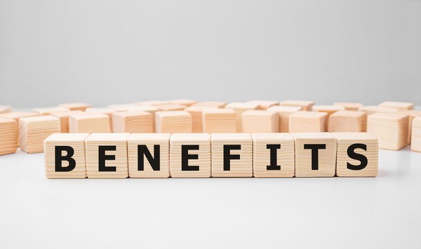 Word BENEFITS made with wood building blocks