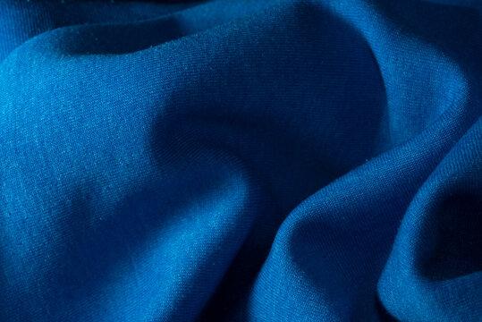 la texture creata da un tessuto di colore blu, una stoffa di colore blu