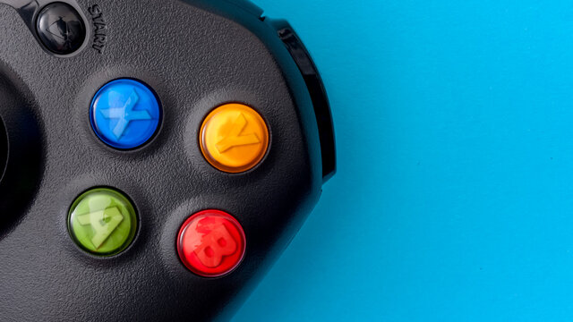 Croydon, UK - 2021, January 11 : Illustrative editorial of Xbox controller isolated on blue background with copy space
