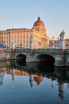 The reconstructed City Palace and a small canal in Berlin before sunset