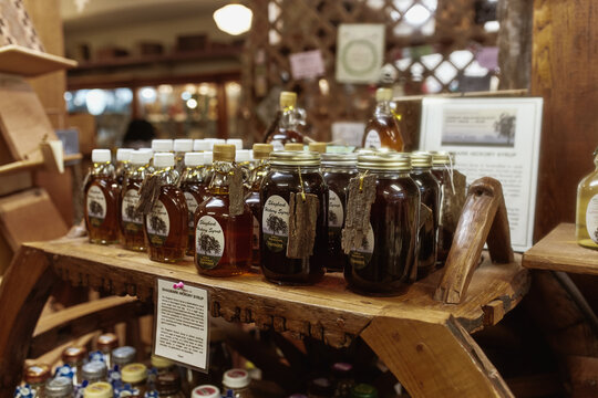 Bennington, Vermont - September 30th, 2019: Variety of New England maple syrup for sale at a general store in Bennington.
