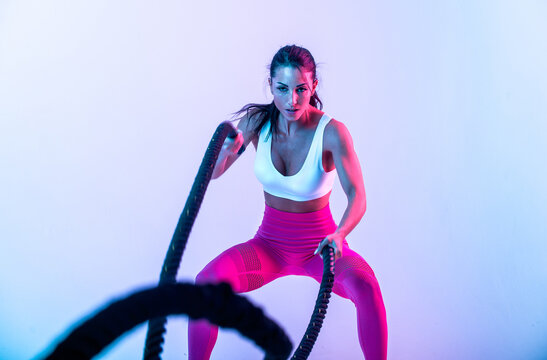 Fit woman training hard with ropes