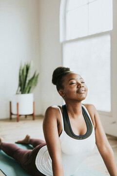 Yoga instructor at a minimal studio