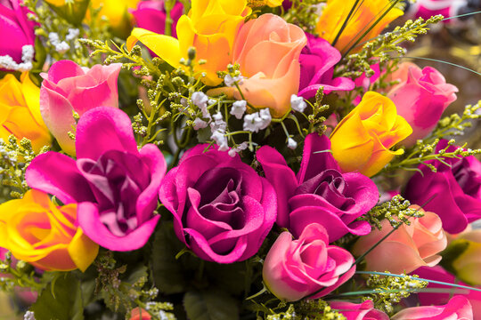 vibrant backgrounds of multicolored fabric flowers.pink and yellow