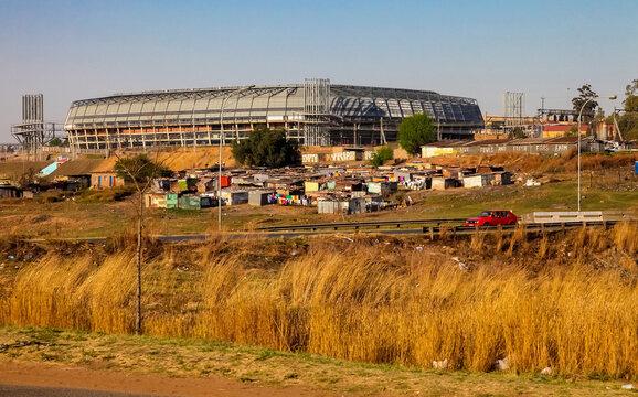 JOHANNESBURG, SOUTH AFRICA - Jul 04, 2018: Informal housing in front of Stadium in Soweto