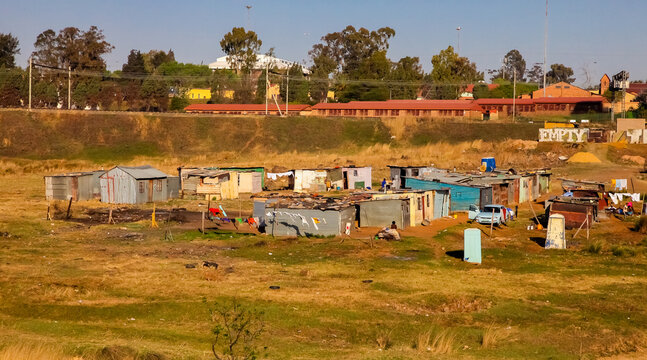 JOHANNESBURG, SOUTH AFRICA - Jul 04, 2018: Low income informal tin shack housing in urban Sowetp