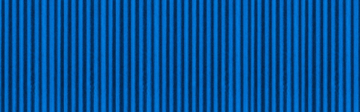 Panorama of New blue galvanized fence with pattern texture and background seamless