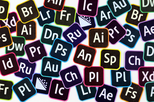 KHARKOV, UKRAINE - DECEMBER 26, 2020: Paper logos of most popular adobe products on white background. Photoshop illustrator bridge indesign premierepro aftereffects lightroom flashbuilder etc