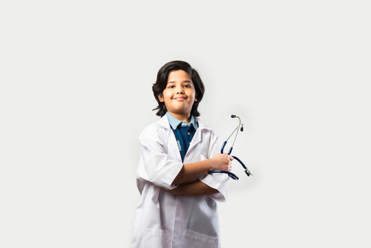 Indian asian kid doctor standing against white background