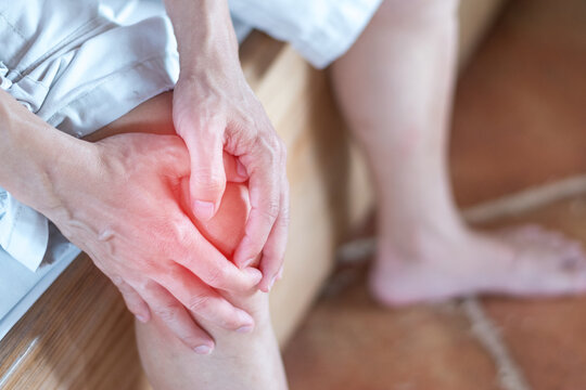 Knee pain disease concept. Hands on leg as hurt from Arthritis, gout or infections.