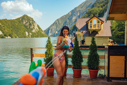 Woman getting splashed with squirt gun