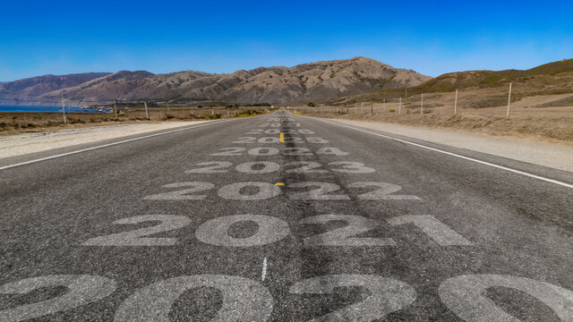2020-2030 written on highway road to the mountain