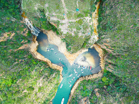 Aerial view of the tourist boats at the waterfall of the Canyons of Furnas at Capitólio - MG, Brazil. Top view of the tourist destination, brazilian eco tourism.