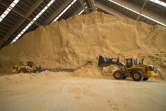 SAN LORENZO, ARGENTINA - Sep 12, 2014: Bulldozers Prepare Soy Flour for Loading Onto a Ship