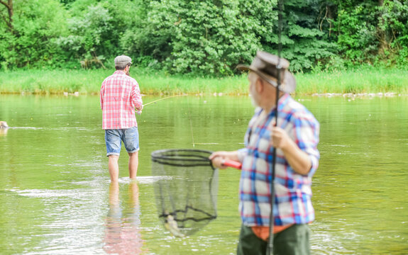Life is always better when I am fishing. Fisherman with fishing rod. Activity and hobby. Fishing freshwater lake pond river. Bearded men catching fish. Mature man with friend fishing. Summer vacation