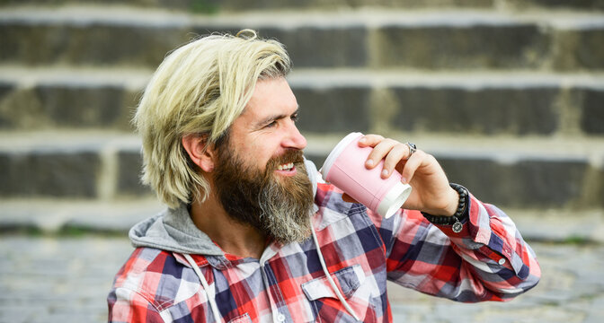 Caffeine dose. Filter coffee. Batch brew is pour over coffee. Having rest. Man with beard drinking coffee. Bearded man drink beverage urban background. Hipster relax on stairs. Take away coffee