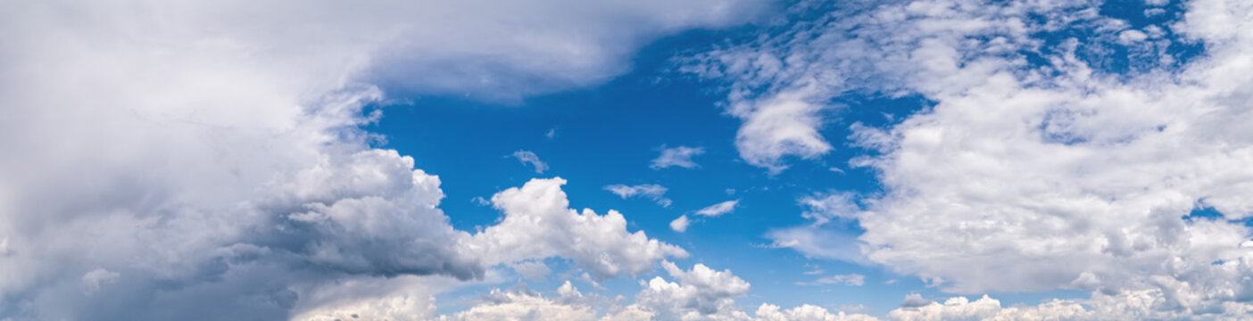 Fuffy clouds in blue sky. Summer good weather skyscape backgroun
