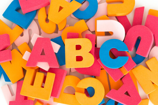 Background of multicolored stacked and messy letters