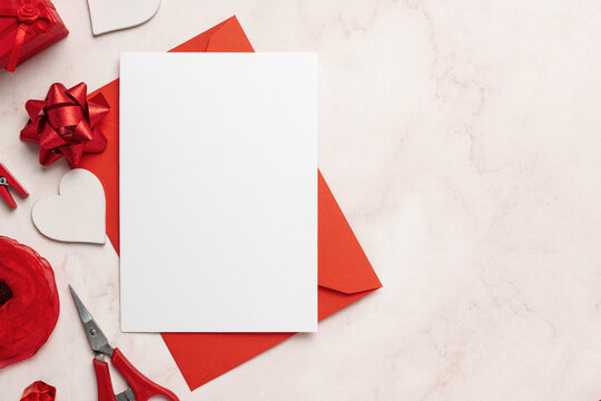Greeting Card on Red Envelope Mockup With Copy Space