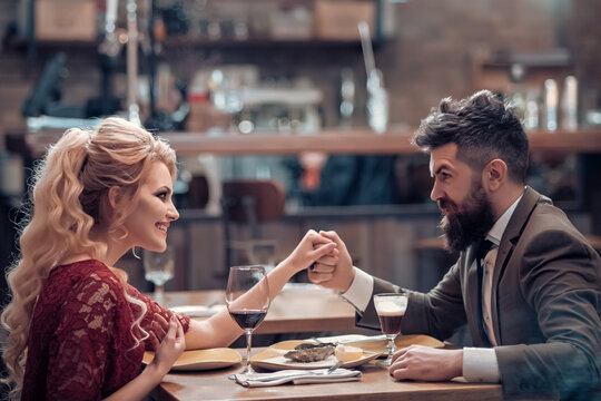 Young happy couple enjoying happy moment in restaurant. Relationship concept. Dating couple.