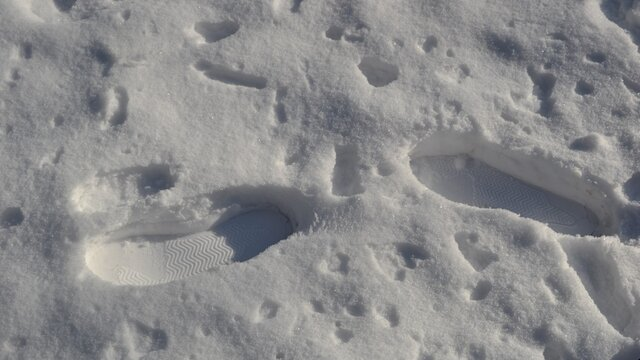 Footprints in the snow. Deep shoeprints in the fresh snow. Track in snow. Natural winter background