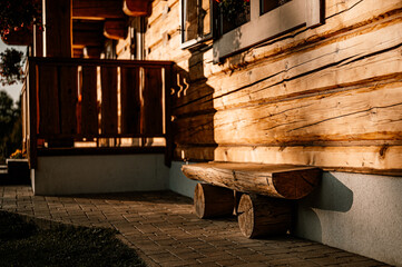 Fototapeta Wooden cottage in nature in sunny day. Recreation center in the mountains. Modern eko hausing in nature. Detail
