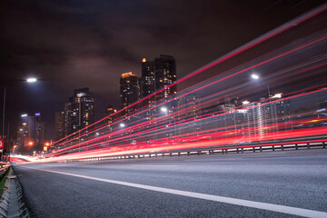 Light Trails On City Street Against Sky At Night