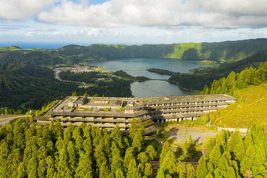 Aerial view of abandoned hotel near Lagoa Azul lake on San Miguel Island, Azores archipelagos, Portugal.