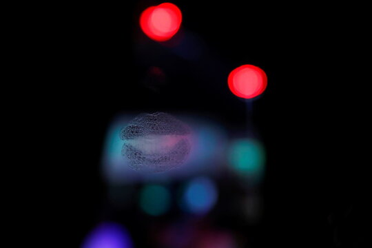 The remnants of a kiss is seen on a mirror ahead of the Tampa Bay area weekend NFL' Super Bowl LV amid the ongoing spread of the coronavirus disease (COVID-19) at the Oz Ladies' & Gentlemen's Nightclub in Clearwater, Florida