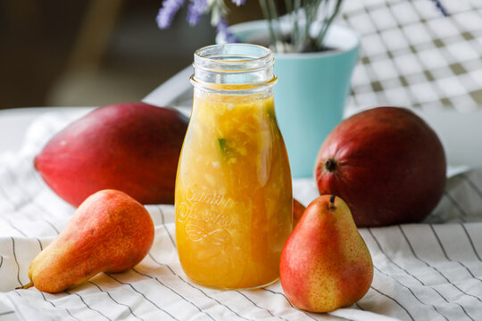 citrus tea with mango and pear in a glass jar
