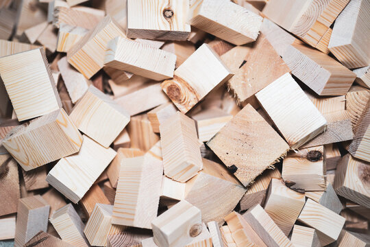 A pile of wooden blocks cut into cubes, all scattered on top of each other. background, texture concept