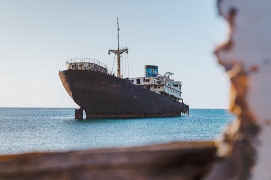Rusty shipwreck on the shore of Arrecife, Lanzarote island, Canary Islands, Spain