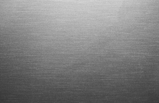 Gray metal background, gradient from white to black