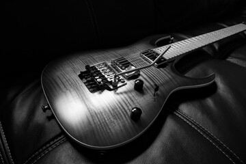 Fototapeta High Angle View Of Guitar On Sofa obraz