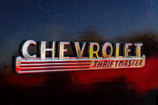 Chevrolet Thriftmaster pick-up truck car logo on a black vintage car shot at an rally in Imperia, Italy, Settember 9, 2020