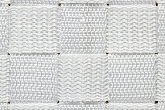 Abstract alternating horizontal and vertical pattern made up of squares of woven white nylon.