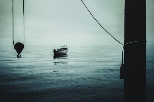 Lonely boat, crane and calm water, horror