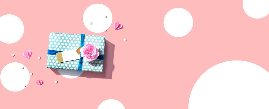 Appreciation theme with a gift box and a pink carnation flower