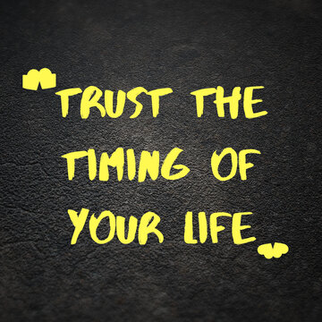 """Yellow quote reading """"Trust the timing of your life"""" on the black background"""
