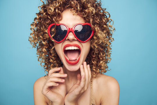 Cheerful woman Wearing dark glasses red lips open mouth look forward