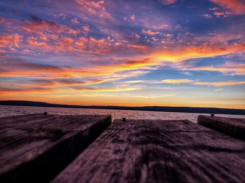 Surface Level Of Wood Against Sea And Sky During Sunset