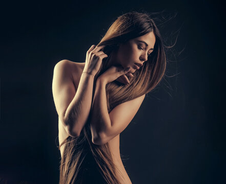 Woman with long hair and naked chest. Hairdresser concept. Woman with very long hair. Beauty hair salon. Haircare and shampoo. Portrait of beauty with beautiful healthy long hair