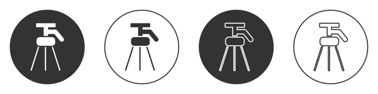 Black Tripod icon isolated on white background. Circle button. Vector Illustration.