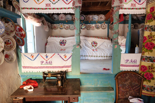 interiors with embroidery around the bed of a house in the village of Olympos, Karpathos island, Greece